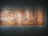 22 muurschildering, waarbij filmpje werd getoond van waar en hoe deze is uitgebikt, overgebracht en hersteld