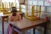 03 Jessika laat zien waar ze in haar klasje zit. Trots en blij dat ze er nu bij kan zijn en dagelijks naar Irpanani kan komen