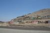01 even buiten Lima, langs de Panamericana Norte op weg naar Trujillo, zeer sobere (sloppenwijk) woningen